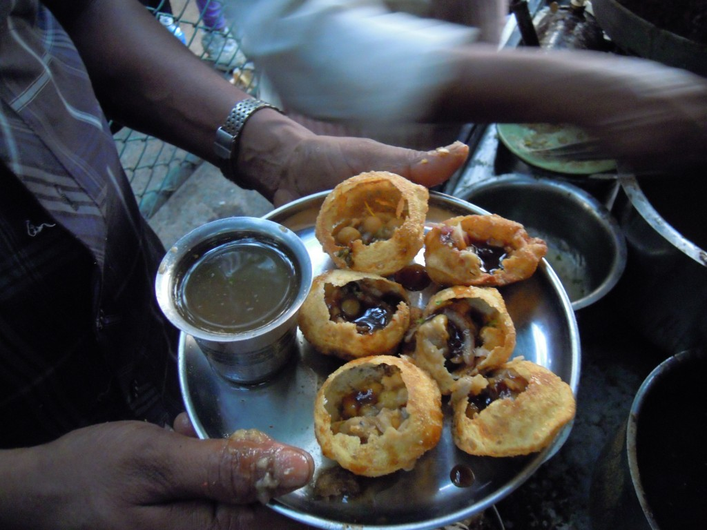 Panipuri - finger licking good, just not those fingers!  Picture courtesy: Hari